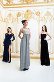 Three women in elegant dresses — 图库照片