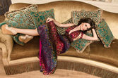 Girl in dress posing  on the sofa — Foto Stock