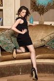 Girl in dress posing on  the sofa — Stock Photo