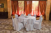 Table in banquet hall — Stock Photo