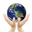 Businessman hands holding planet Earth . — Stock Photo