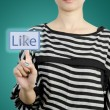 Women touching like button screen — Stock Photo #35032711
