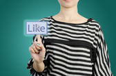 Women touching like button screen — Stock Photo
