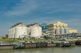 Metal silos agriculture granary and ship port — ストック写真