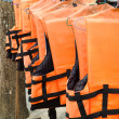 Stock Photo: Orange life jackets