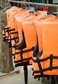 Orange life jackets — Stock Photo