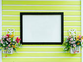 Blank sign on green wall — Stock Photo