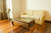 Sofa furniture on a wooden  — Stock Photo