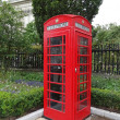 Typical Red London Telephone Booth - Stock Photo
