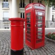 Typical Red London Telephone Booth and Pillar Box - Stock Photo