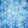 Christmas seamless blue pattern background with bright snowflakes and stars. — Stock Vector
