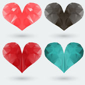 Set of polygonal colored hearts on a gray background. — Stock Vector