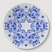 Blue round floral ornament.  Pattern applied to the ceramic plate — Stok Vektör