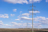 Power line of electricity transmissions — Stock Photo