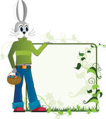 Easter rabbit with a basket of eggs — Stock Vector