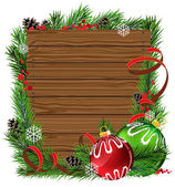 Christmas balls and pine branches on wooden board — Vector de stock