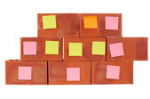 Clay bricks and pasted stickers — Stock Photo