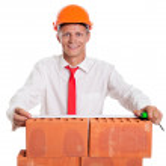 Businessman with bricks — Stock Photo