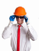 A construction worker with sunglasses on — Stock Photo