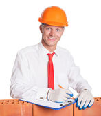 Businessman with bricks on white — Stock Photo