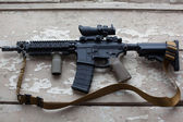 US Spec Ops M4A1 on the background of the destroyed window — Stock Photo
