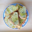 Stock Photo: Bread slices served in a plate with olive oil and oregano condiment