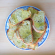 Stock Photo: Bread slices served in plate with olive oil and oregano condiment