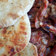 Barbecue food and pita bread — Stock Photo
