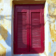 Colorful wooden window, shutters closed — Stock Photo