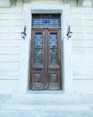 Old elegant wooden door — Stock Photo