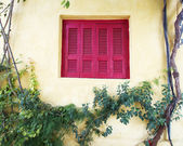 House facade with red shutters window — Stock Photo