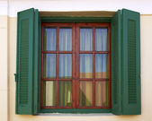 Green shutters window — Stock Photo