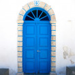 Traditional Greek church blue door — Stock Photo #21451725