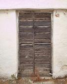 Door on white wall — Stock Photo
