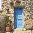 Stock Photo: Blue door and flowerpot