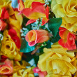 Colorful fake roses, floral background — Stock Photo