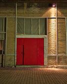 Old industrial building red door — Stock Photo