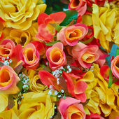 Variety of fake roses, floral background — Stock Photo