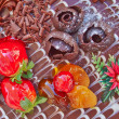 Chocolate cake with strawberries and fruits — Stock Photo