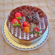 Chocolate cake with strawberries and fruits — Stockfoto