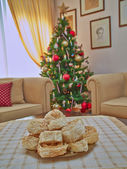 Xerotigana, traditional Greek sweet round fries and Christmas tree bokeh — Stock Photo