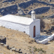 Lonely white church on mountain slopes — Stock Photo