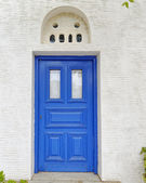 Blue door of a typical Mediterranean island house — Stock Photo