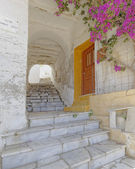 Alley and bougainvillea flower in a Mediterranean island — Stock Photo