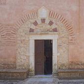 Medieval church entrance — Stock Photo