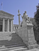 Socrates the philosopher and Apollo the god of arts in front of the national university of Athens — Stock Photo