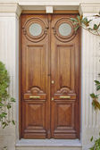 "Double ""ox eye"" door, Athens Greece — Stock Photo"