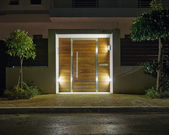 Contemporary house entrance night view — Stock Photo