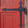 Vintage red door and hinge detail — Stock Photo #50102489