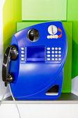 Blue public pay telephone — Stock Photo